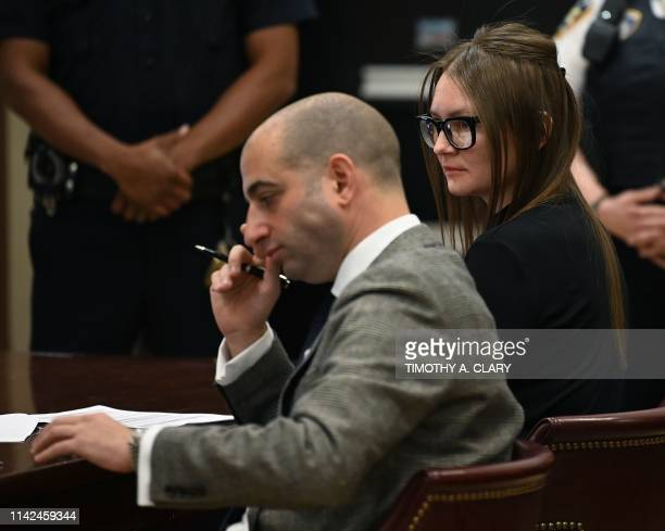 Fake German heiress Anna Sorokin sits next to her attorney Todd Spodek during her sentencing at Manhattan Supreme Court May 9 2019 following her...