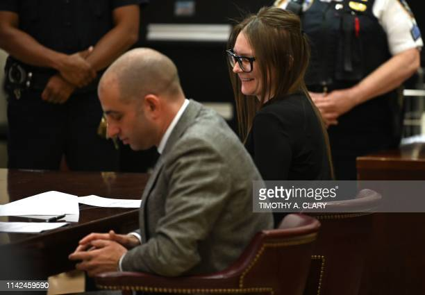 Fake German heiress Anna Sorokin sits smiling next to her attorney Todd Spodek during her sentencing at Manhattan Supreme Court May 9 2019 following...