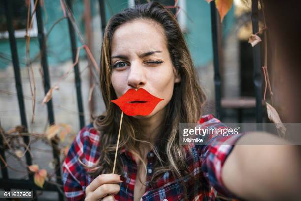 fake lips selfie - big lips stock photos and pictures