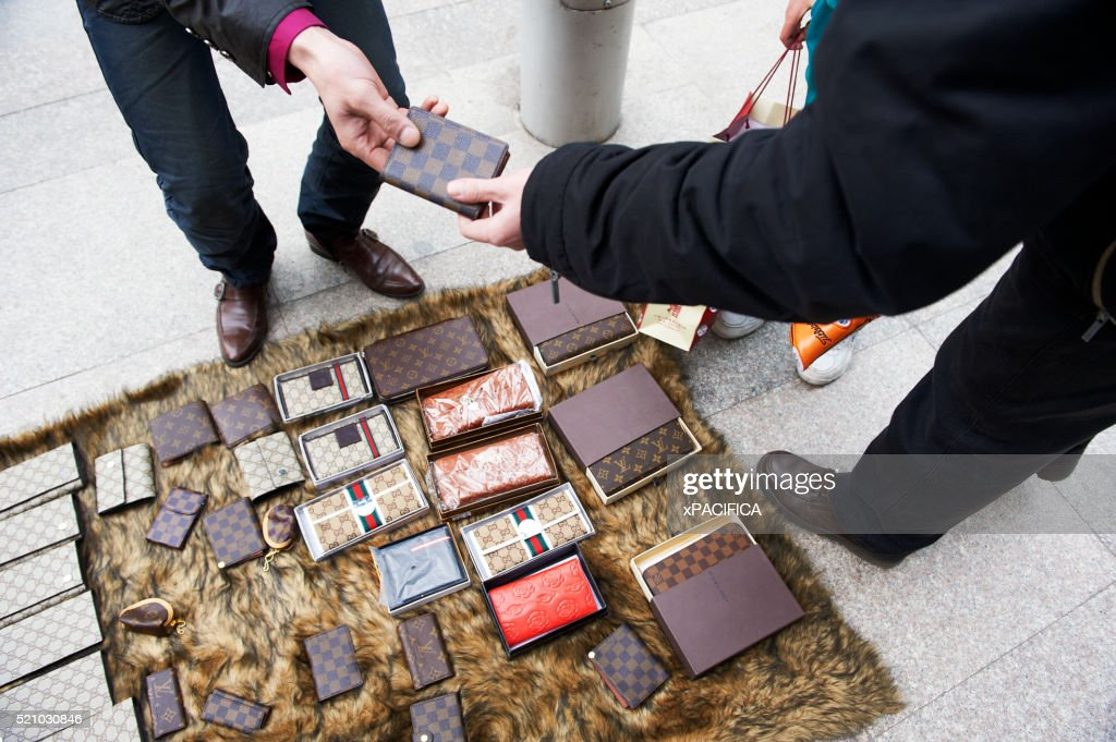 Fake Louis Vuitton Wallets being sold on the street. March 29, 2010 : Stock Photo