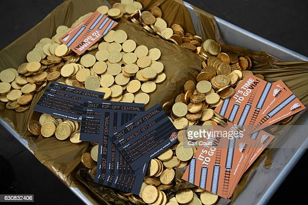Fake money and flyers are displayed in a wheelbarrow during a demonstration against rail fare increases on January 3 2017 in London United Kingdom...