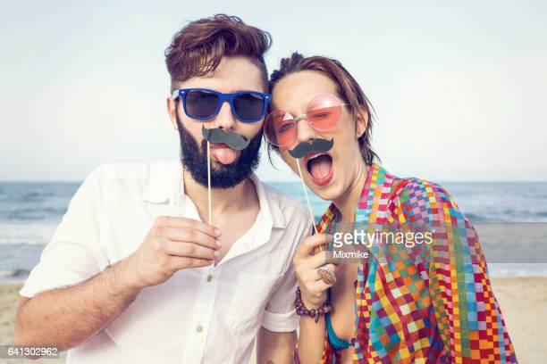 fake mustache fun - acting stock pictures, royalty-free photos & images