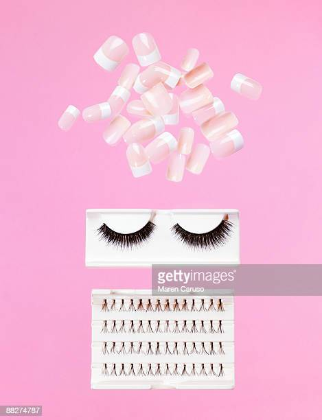fake nails and eye lashes - false eyelash stock pictures, royalty-free photos & images