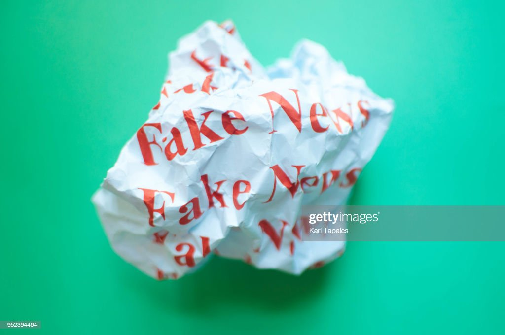 Fake news against blue green background : Stock Photo