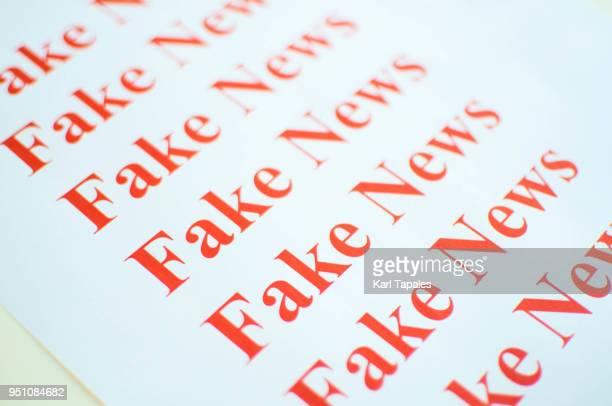 Fake news against white background