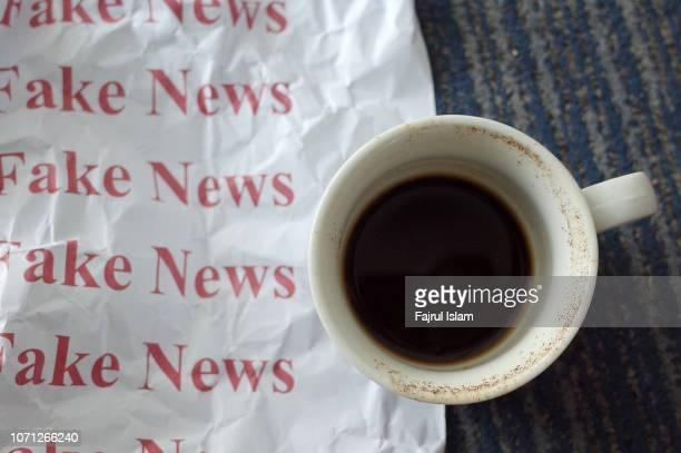 fake news and coffee cup - fake imagens e fotografias de stock