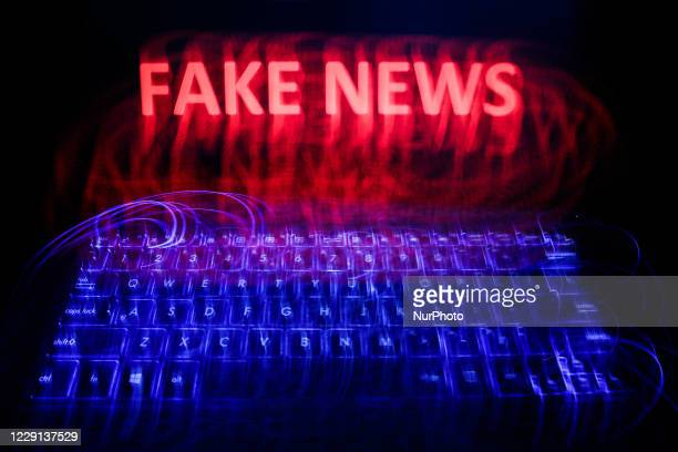 'Fake news' sign is seen displayed on a laptop screen in this long exposure illustration photo taken on June 13, 2020.