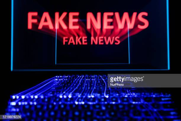 'Fake news' sign is seen displayed on laptop screen in this long exposure illustration photo taken in Poland on June 13, 2020. European Commission...