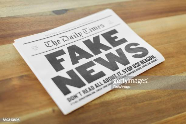 fake newspaper on kitchen table - fake stock pictures, royalty-free photos & images