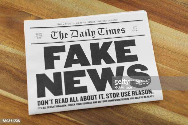 fake newspaper on kitchen table - fake news foto e immagini stock
