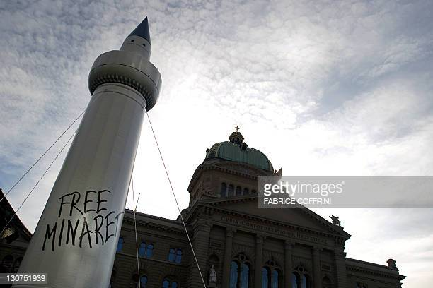 A fake plastic minaret is seen in front of the Swiss House of Parliament during a protest organized by the Islamic Central Council of Switzerland on...