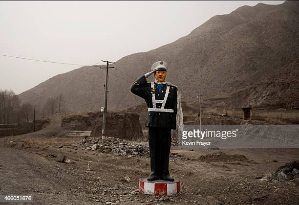 A fake traffic police officer is seen at the side of the road on a highway on March 3 2015 near the Labrang Monastery Xiahe County Amdo Tibetan...