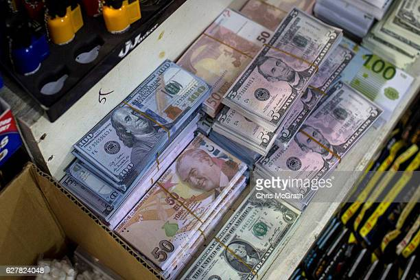 Fake US Dollar and Turkish Lira currency often used as a novelty gift is seen for sale at a tobacco shop in a market on December 5, 2016 in Istanbul,...