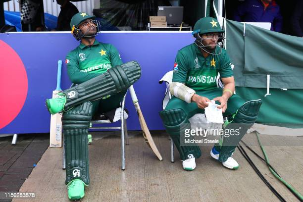 Fakhar Zaman and Imam ul Haq the opening batsmen of Pakistan wait for the rain to stop before their innings during the Group Stage match of the ICC...