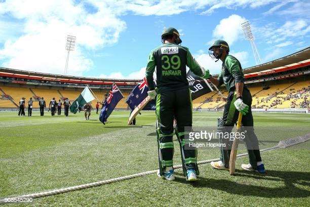 Fakhar Zaman and Shoaib Malik of Pakistan take the fieldduring game one of the Twenty20 series between New Zealand and Pakistan at Westpac Stadium on...