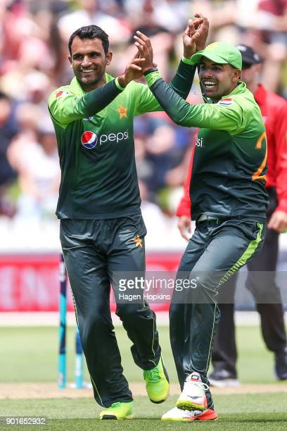 Fakhar Zaman of Pakistan celebrates with Shadab Khan after taking the wicket of Martin Guptill during game one of the One Day International Series...