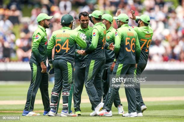 Fakhar Zaman of Pakistan celebrates with teammates after taking the wicket of Martin Guptill during game one of the One Day International Series...