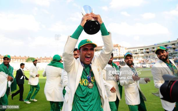 Fakhar Zaman of Pakistan celebrates with the trophy during the ICC Champions Trophy Final match between India and Pakistan at The Kia Oval on June 18...