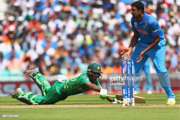 Fakhar Zaman of Pakistan dives to make his ground during the ICC Champions trophy cricket match between India and Pakistan at The Oval in London on...