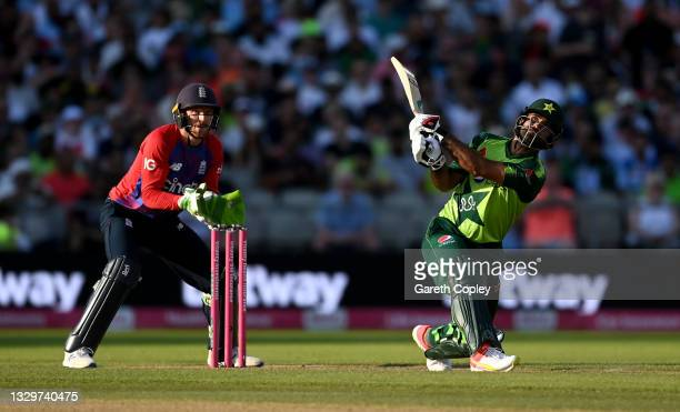 Fakhar Zaman of Pakistan hits out for six runs watched by England wicketkeeper Jos Buttler during the Third Vitality International T20 match between...