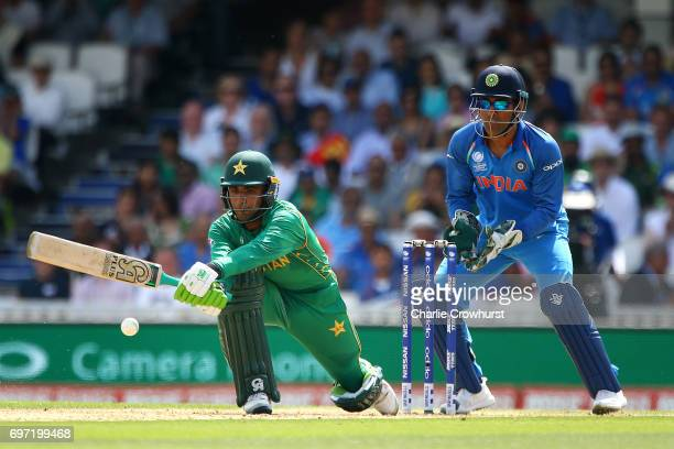 Fakhar Zaman of Pakistan hits out while wicket keeper MS Dhoni of India looks on during the ICC Champions Trophy Final match between India and...