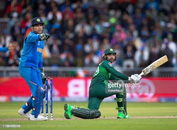 Fakhar Zaman of Pakistan is caught out with M S Dhoni keeping wicket during the Group Stage match of the ICC Cricket World Cup 2019 between Pakistan...