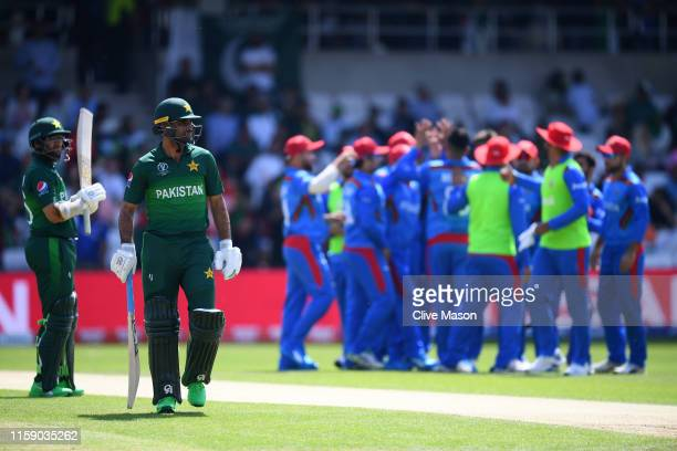 Fakhar Zaman of Pakistan walks off after being dismissed by Mujeeb Ur Rahman of Afghanistan during the Group Stage match of the ICC Cricket World Cup...