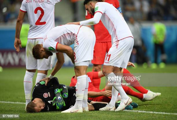 Fakhreddine Ben Youssef and Dylan Bronn of Tunisia check if team mate Farouk Ben Mustapha is ok during the 2018 FIFA World Cup Russia group G match...