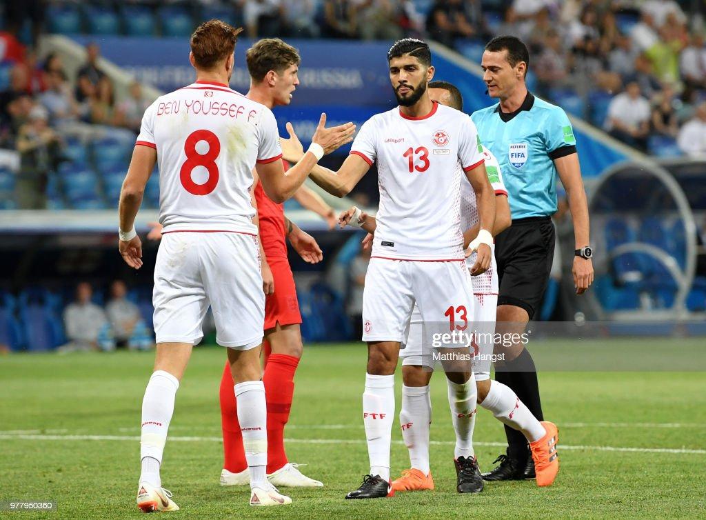 Fakhreddine Ben Youssef and Ferjani Sassi of Tunisia shake
