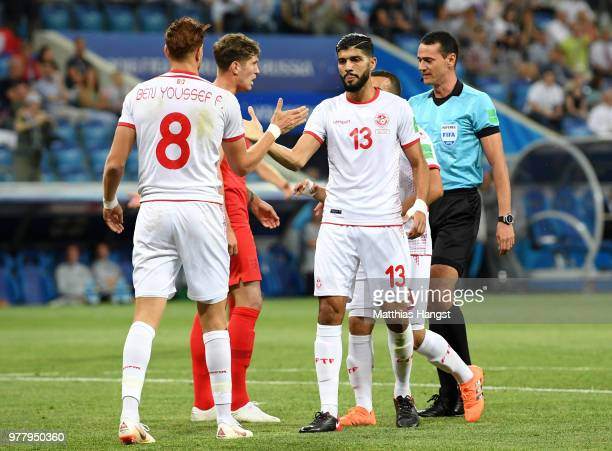 Fakhreddine Ben Youssef and Ferjani Sassi of Tunisia shake hands as a penalty is awarded to them during the 2018 FIFA World Cup Russia group G match...