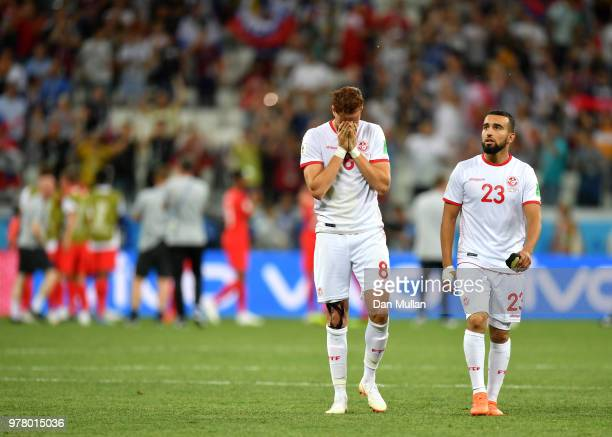 Fakhreddine Ben Youssef and Naim Sliti of Tunisia look dejected following their sides defeat in the 2018 FIFA World Cup Russia group G match between...