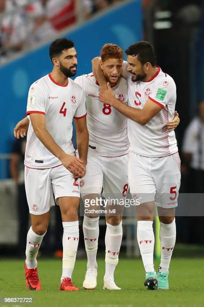 Fakhreddine Ben Youssef of Tunisia celebrates with teammates Oussama Haddadi and Yassine Meriah after scoring his team's first goal during the 2018...