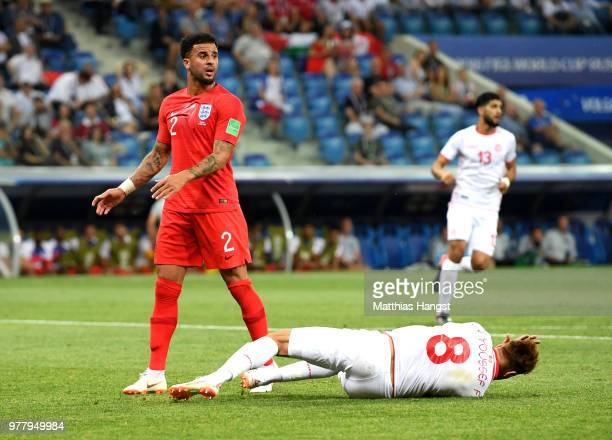 Fakhreddine Ben Youssef of Tunisia goes down leading to a penalty awarded as Kyle Walker of England reacts during the 2018 FIFA World Cup Russia...
