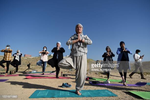 Fakhria Momtaz trainer and founder of Kabul's first yoga center for Woman,take part in a yoga session during International Yoga Day,at the Shahrak...