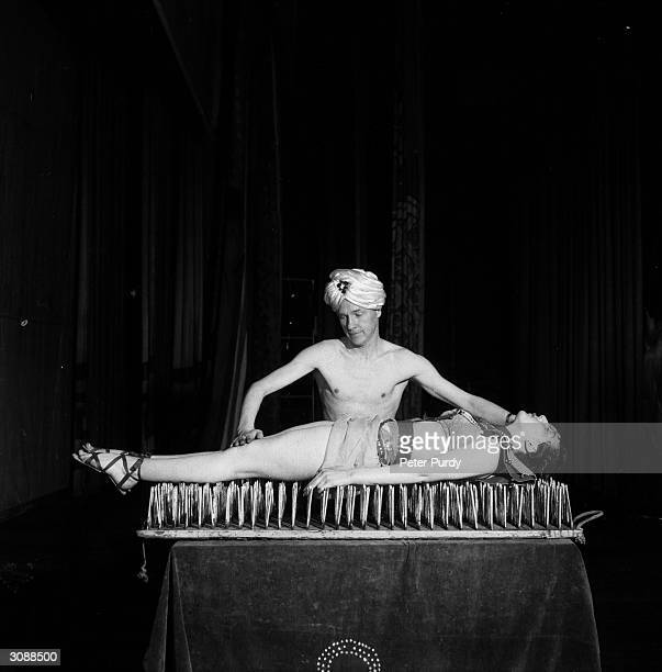 A fakir performing the bed of nails trick