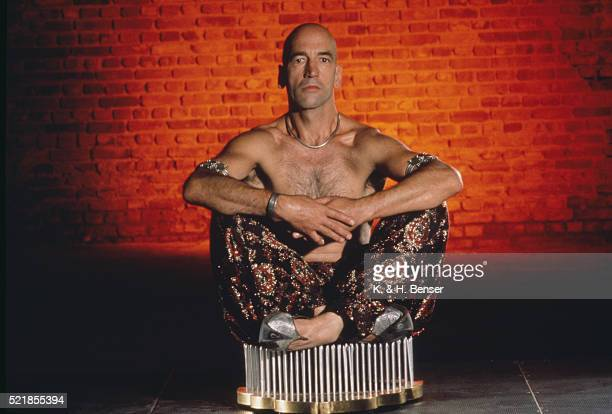 fakir sitting on a bed of nails