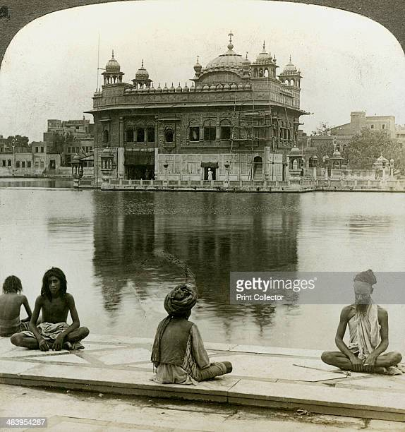 Fakirs at Amritsar looking south across the Sacred Tank to the Golden Temple India c1900s Stereoscopic card The Golden Temple at Amritsar is the...