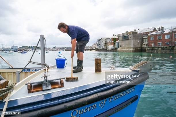 Fal River Ferries crew member Orlando Smithies works on board as the ferry company undertakes a trial voyage while preparing their vessels for...