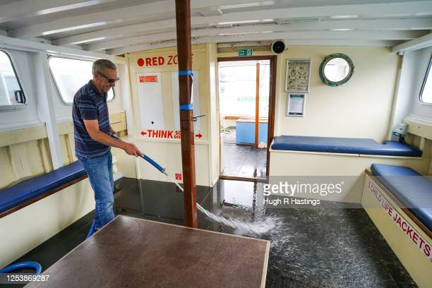 Fal River Ferries skipper John Topper MetcalfBrown works on board as the ferry company undertakes a trial voyage while preparing their vessels for...