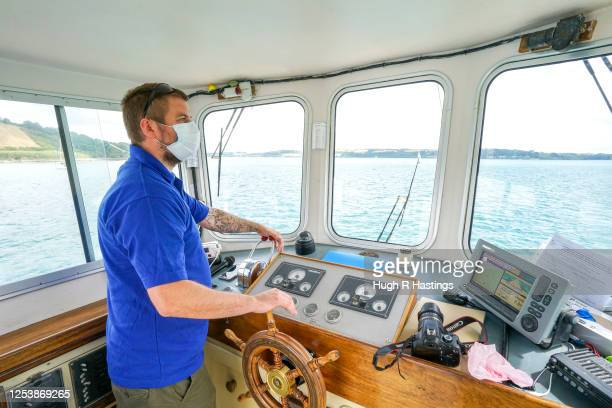 Fal River Ferries skipper Sam Norman at the helm as the ferry company undertakes a trial voyage while preparing their vessels for carrying passengers...