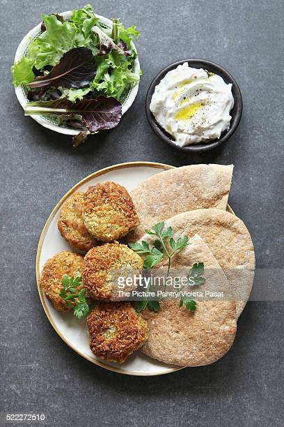 Falafel balls with yogurt dip and lettuce.Top view