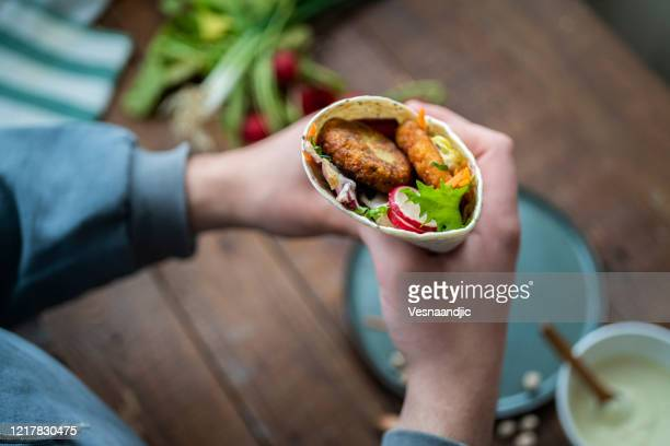falafel in tortila wrap's - tortilla flatbread stock pictures, royalty-free photos & images