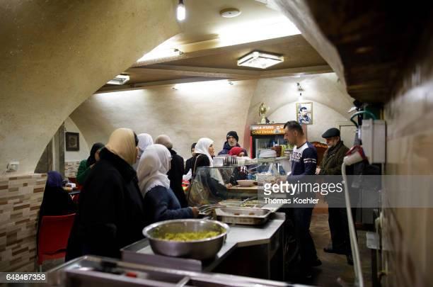 Falafel snack bar street scene in the Muslim quarter of the historic city center of Jerusalem on February 08 2017 in Jerusalem Israel