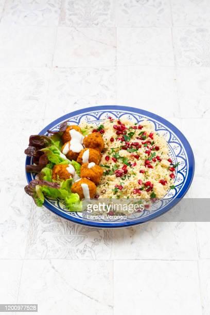falafel with tabbouleh salad on a plate - bulgur bildbanksfoton och bilder