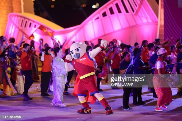 Falah mascot of the championships takes part in the opening ceremony at the 2019 IAAF World Athletics Championships at the Khalifa International...