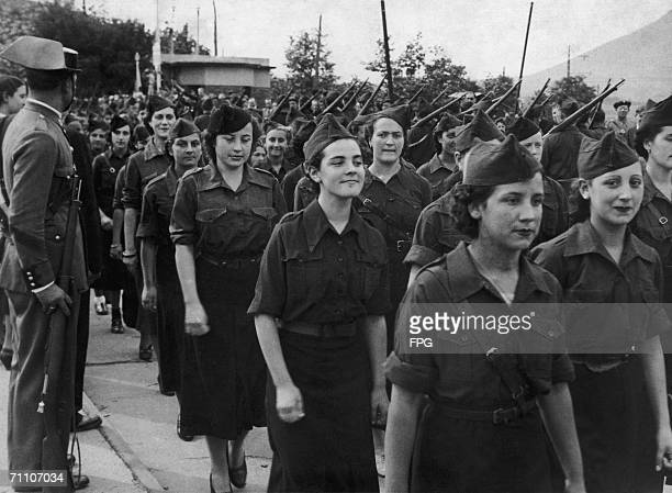 Falangist woman march through Irun in northern Spain to celebrate the city's liberation from Republican rule during the Spanish Civil War 5th October...