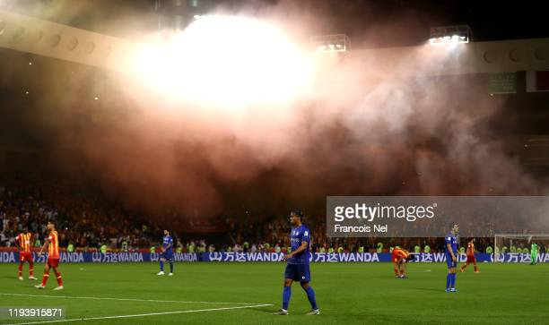 A falare is set off by fans during the FIFA Club World Cup 2nd round match between Al Hilal and Esperance Sportive de Tunis at Jassim Bin Hamad...