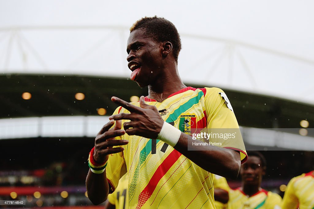 Falaye Sacko of Mali celebrates a goal from Adama Traore of Mali during the FIFA U-20 World Cup Third Place Play-off match between Senegal and Mali at North Harbour Stadium on June 20, 2015 in Auckland, New Zealand.
