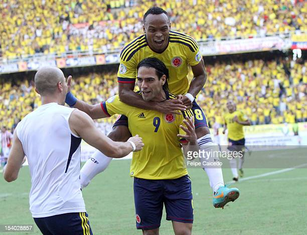 Falcao Garcia and Camio Zuñiga of Colombia celebrate a goal during a match between Colombia and Paraguay as part of the South American Qualifiers for...