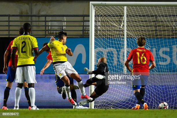 Falcao Garcia of Colombia scores his team's second goal during a friendly match between Spain and Colombia at La Nueva Condomina stadium on June 7...
